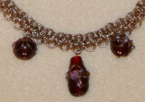 Close up of necklace. I am loving the Venetian glass beads!